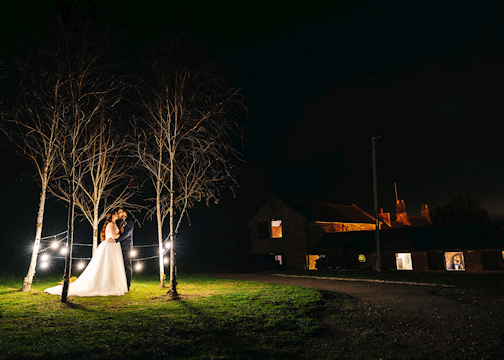 Dodmoor House Wedding Venue at Night with Bride and Groom.