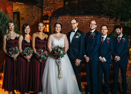 Bride, Groom, Bridesmaids and Groomsmen standing together.