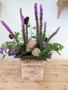 Flower arrangement using sticks for mechanics.