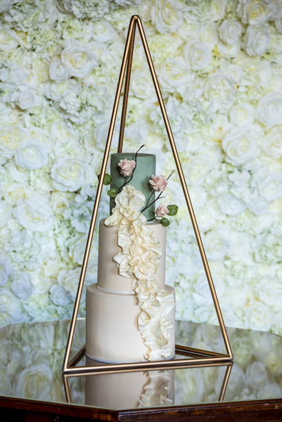 Gold wedding cake frame.